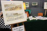 Présentation d'aquarelles sur le stand de Jean Marie